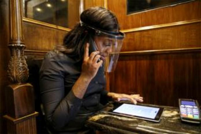 A receptionist makes an appointment by phone