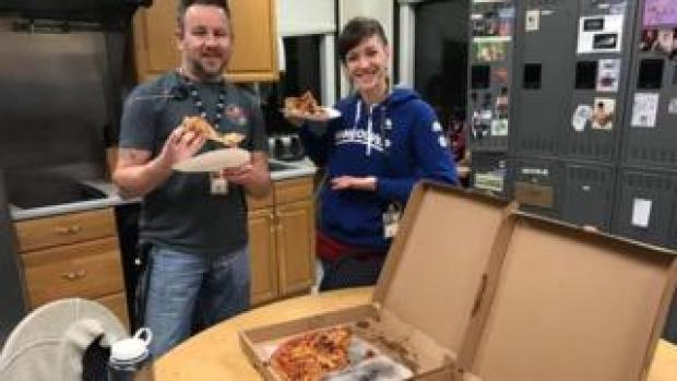 Staff in Portland, Maine enjoying pizza from counterparts across the border in Moncton, New Brunswick