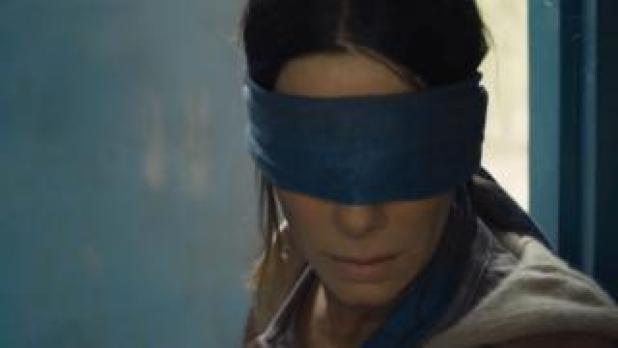 Sandra Bullock in a blindfold