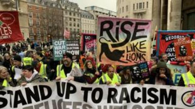Crowds protesting against austerity in yellow vests