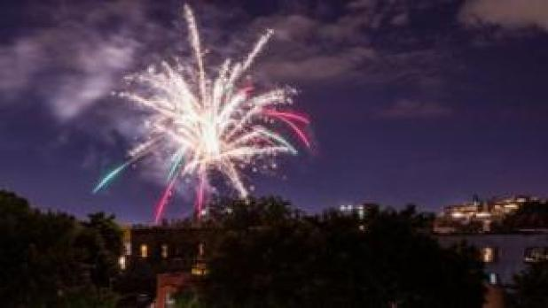 Illegal fireworks light up the sky over the Bedford-Stuyvesant neighborhood of New York's Brooklyn district on June 19