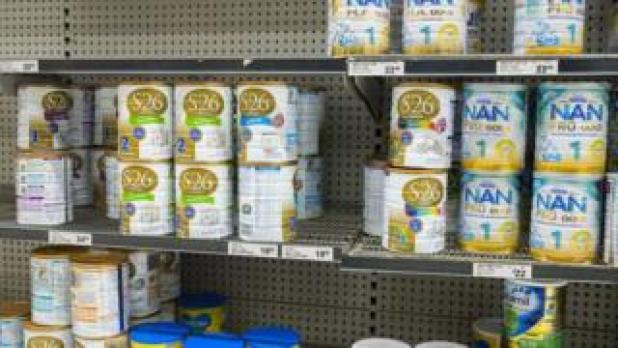 Cans of infant formula in an Australian supermarket