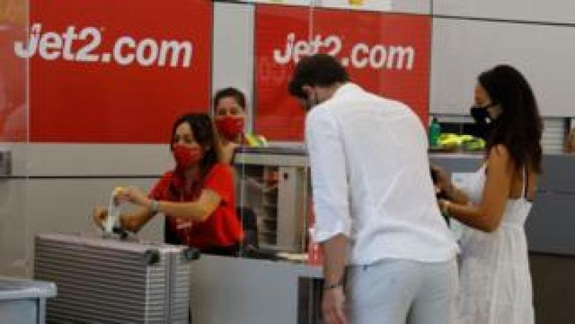 Jet2.com customers at a check-in desk