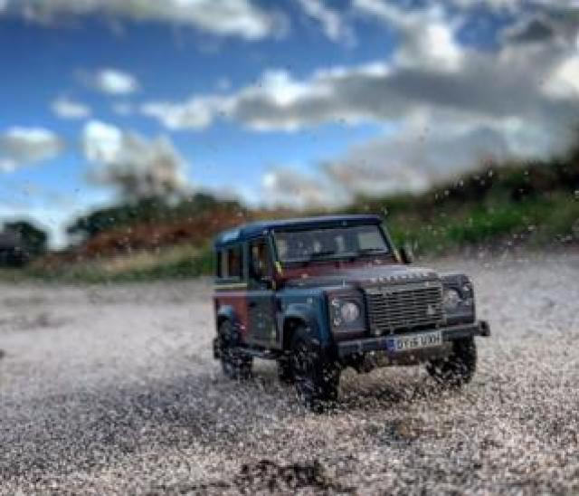 Model Land Rover Defender on gravel track