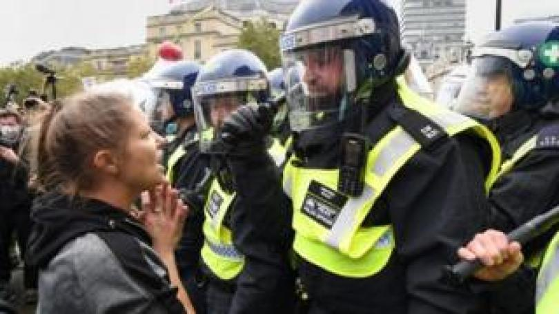 Protesters and police at a