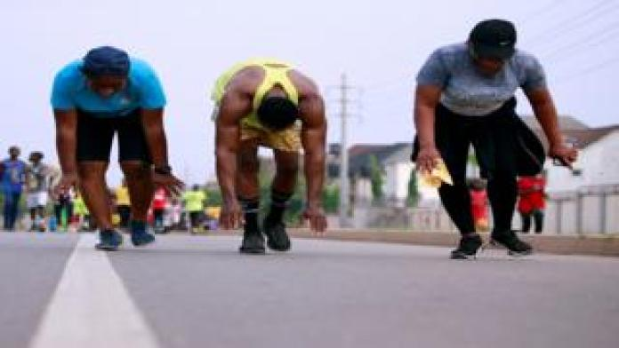 People are seen during an exercise session in Nigeria