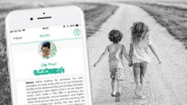 Screen grab of Bubble app and two young children walking down a track holding hands