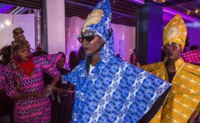 Congolese fashion designer Liputa Swagga (left) checking on models wearing her outfits at Dakar Fashion Week in Dakar, Senegal