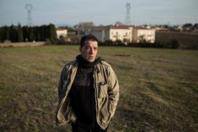 Michel Soules in the field where new houses are being built for the Gypsy community