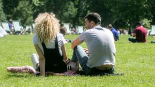 Two people relaxing in a park