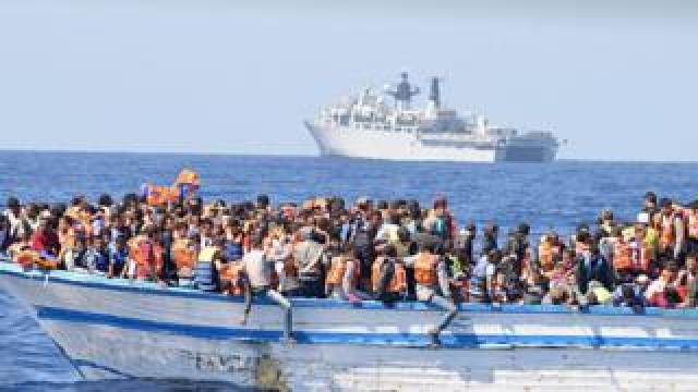 Migrants on a boat in the Mediterranean
