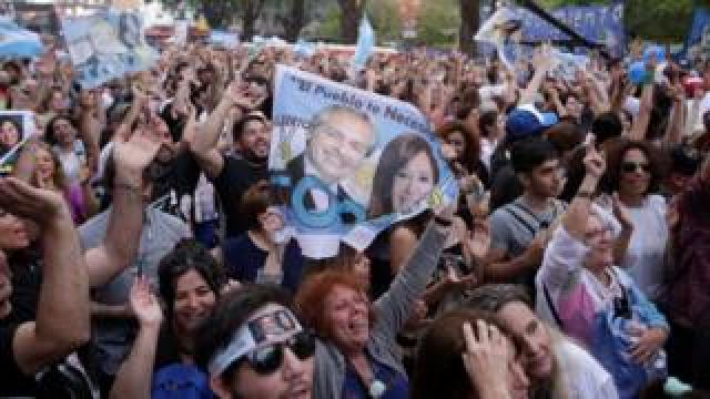 Supporters of presidential candidate Alberto Fernandez, and his running mate, former President Cristina Fernandez de Kirchner, gather during general elections in Buenos Aires, Argentina, 27 October, 2019.