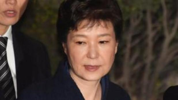 Ousted South Korean President Park Geun-hye leaves after hearing on a prosecutors' request for her arrest for corruption