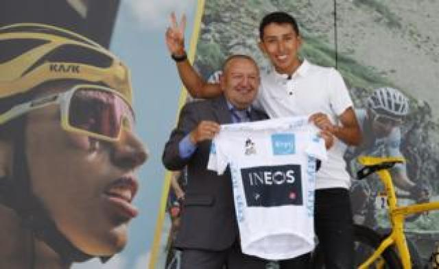 Colombian cyclist Egan Bernal, winner of the Tour de France 2019, poses with his first coach Fabio Rodriguez (L) during a tribute celebrated at his hometown, Zipaquira, in Cundinamarca, Colombia