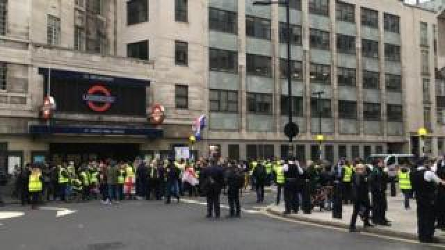 Protesters outside St James's Park Tube station, where the arrest took place