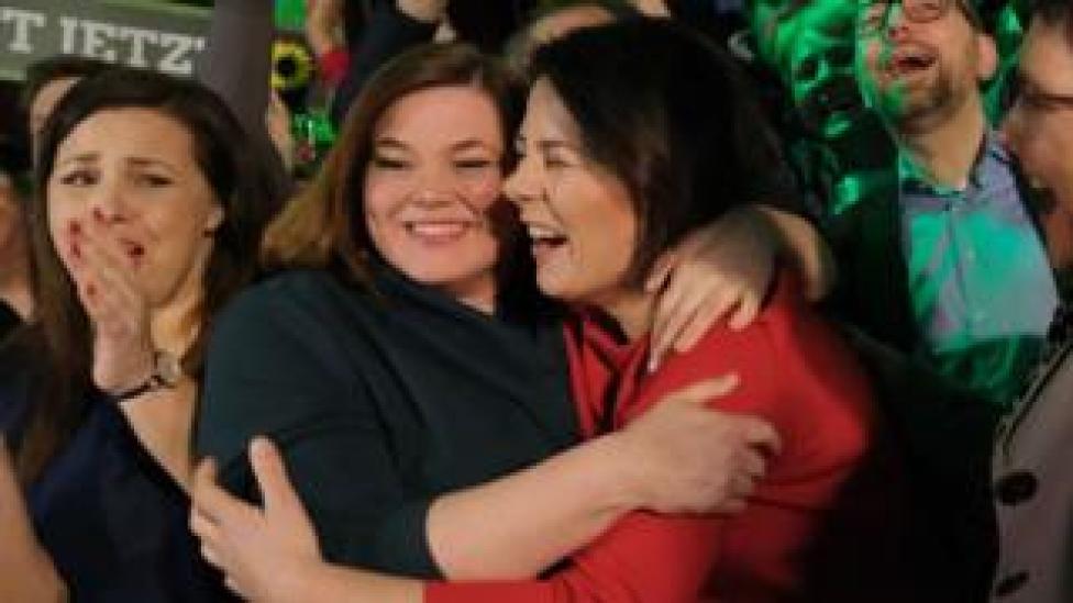 Top Greens candidate Katharina Fegebank (L) celebrates with national co-leader Annalena Baerbock (R)