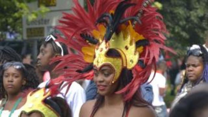 Woman in elaborate headdress parade