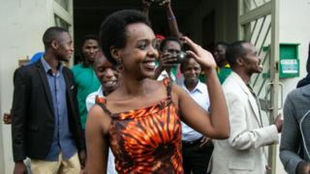 Diane Rwigara (front L), a critic of Rwanda's President, reacts as she leaves the Kigali's High Court