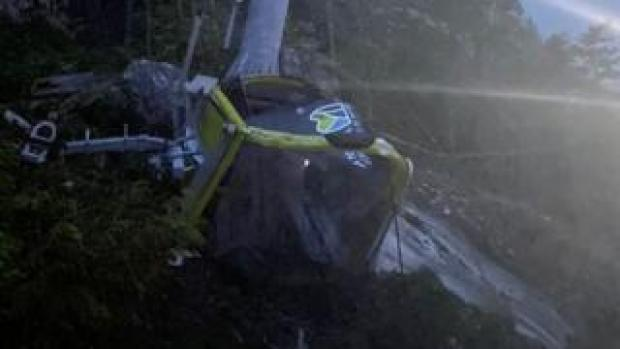 A cable car crumpled on the ground after the gondola ride was saboaged