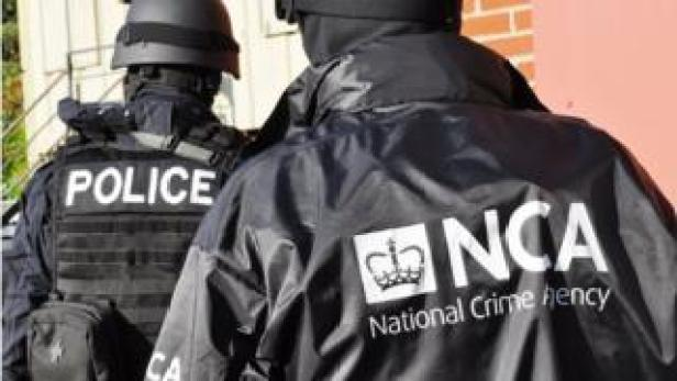 Police and NCA officers