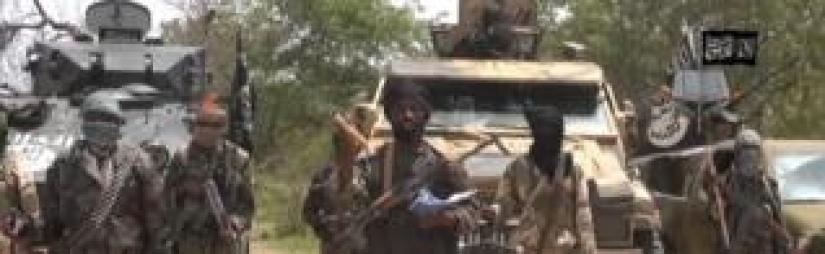 A screengrab taken on 13 July 2014 from a video released by Boko Haram and obtained by AFP shows the leader Abubakar Shekau (C)