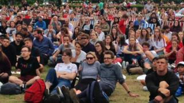 A mass of England fans in Battersea Park, London., watching England