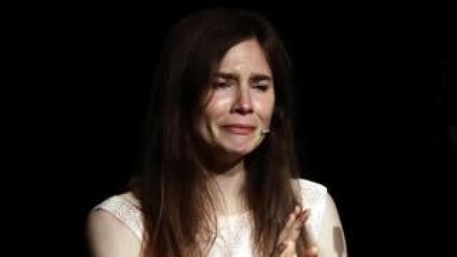 Amanda Knox cries as she attends the conference of the Criminal Justice Festival at the University of Modena,