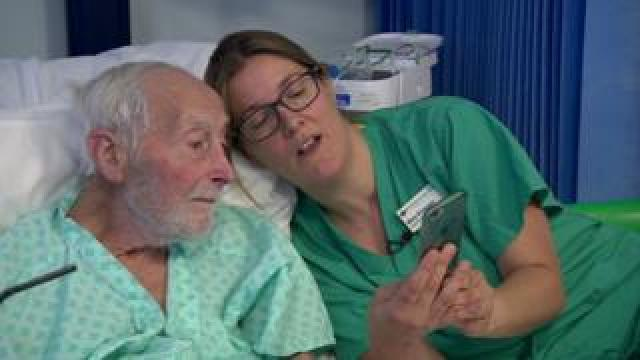 Specialist nurse Mary talks to a patient about his results