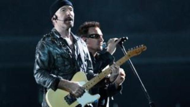 U2's The Edge and Bono performing on stage