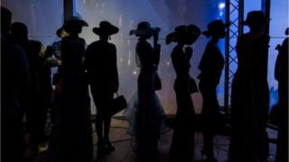 A group of models wait patiently moments before a show at Radisson Blu Hotel during Dakar Fashion Week in Dakar, Senegal