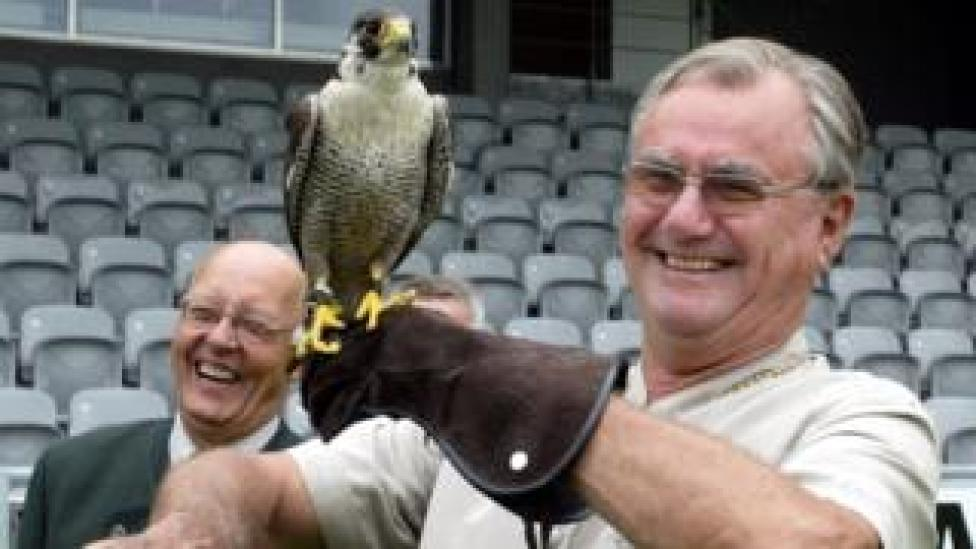 """In this file photo taken on July 8, 2006, Prince consort of Denmark Henrik holds a hawk """"Phoenix 2"""" as falconer trainer Frank Skaarup Hansen of Sonderup laughs, before the official opening ceremony of the European Hunting Horn championship held in Horsens, Jutland"""