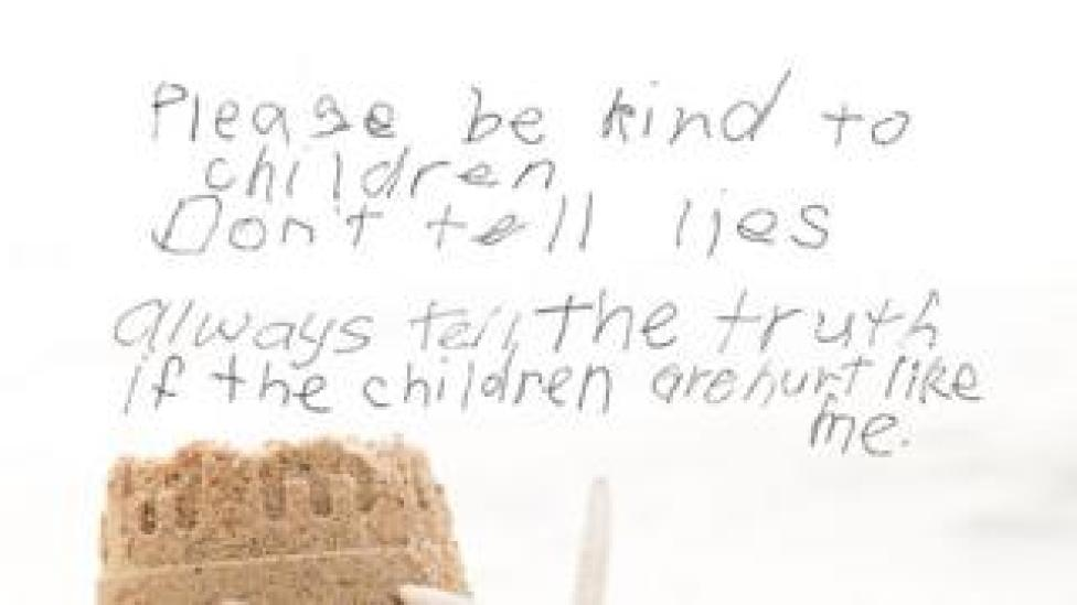"""A message from a survivor reads: """"Please be kind to children. Don't tell lies. Always tell the truth if the children are hurt like me."""""""