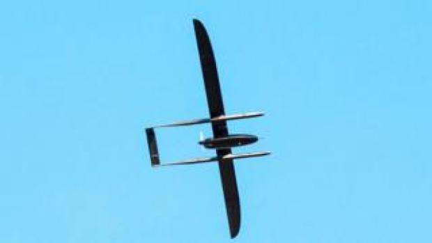 The offending UAV is seen in this photo silhouetted against a blue sky