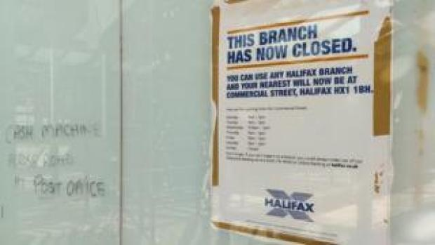 A poster saying that a branch of Halifax has closed
