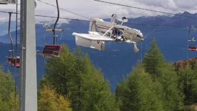 A plane left dangling in the Italian Alps