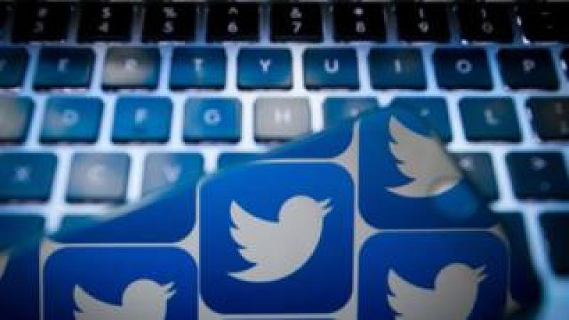 Twitter logo and computer keyboard