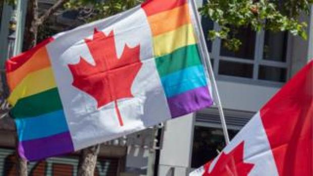 A Canadian flag in the rainbow colours of LGBT pride