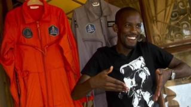 Mandla Maseko with his spacesuits in Mabopane, near Pretoria, South Africa. Photo: 9 January 2014