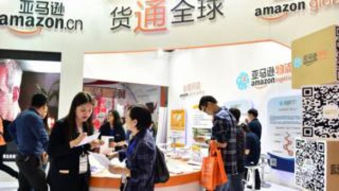 Visitors at an Amazon booth during the 2016 China International Electronic Commerce Expo in Yiwu, east China's Zhejiang province.
