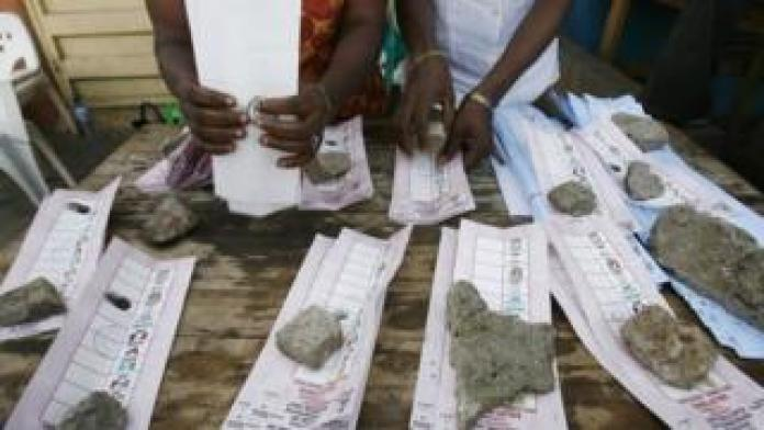 Scrutineers organise ballots papers on election day, 21 April 2007, in Lagos, Nigeria