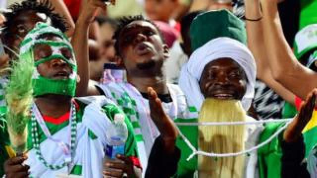 A Nigeria supporter cheers during the 2019 Africa Cup of Nations (CAN) quarter final football match between Nigeria and South Africa at Cairo international stadium on July 9, 2019.
