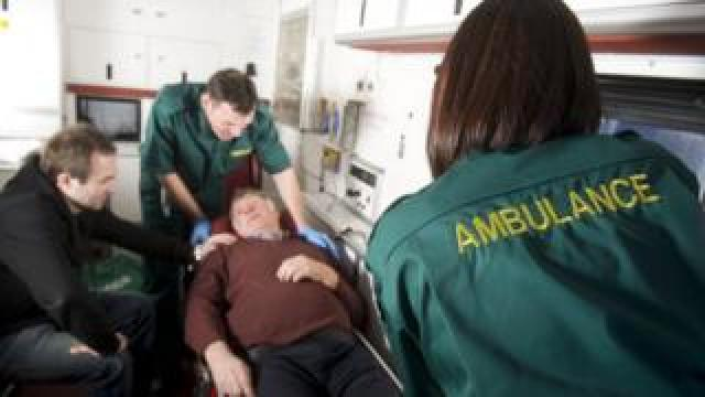 Ambulance crew with patient
