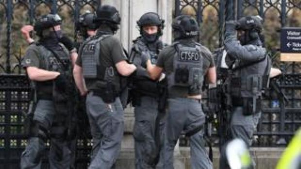 Counter-terrorism officers outside the Houses of Parliament