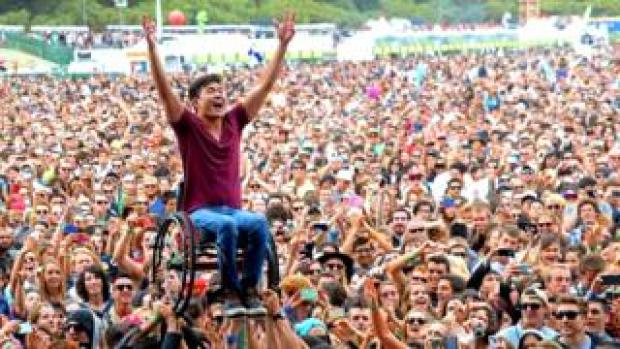 A wheelchair users crowd-surfs at California's Outside Lands festival