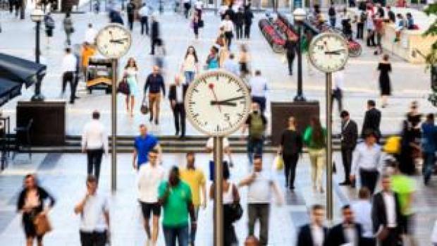 People walking across Canary Wharf