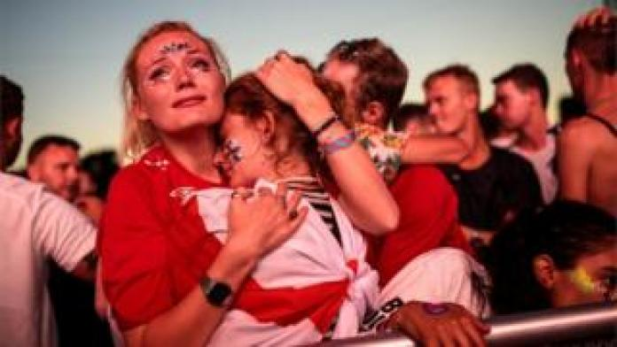 Fans console each other at London's Hyde Park