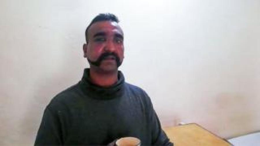 "In this handout photograph released by Pakistan""s Inter Services Public Relations (ISPR) on February 27, 2019, shows captured Indian pilot looking on as holding a cup of tea in the custody of Pakistani forces in an undisclosed location"