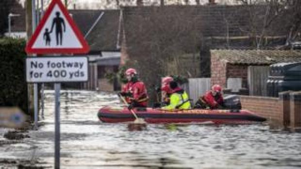 Rescue workers travelling by boat in East Cowick, Yorkshire
