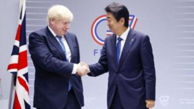 British Prime Minister Boris Johnson and Japanese Prime Minister Shinzo Abe shake hands during their bilateral meeting on the sidelines of the G7 Summit.
