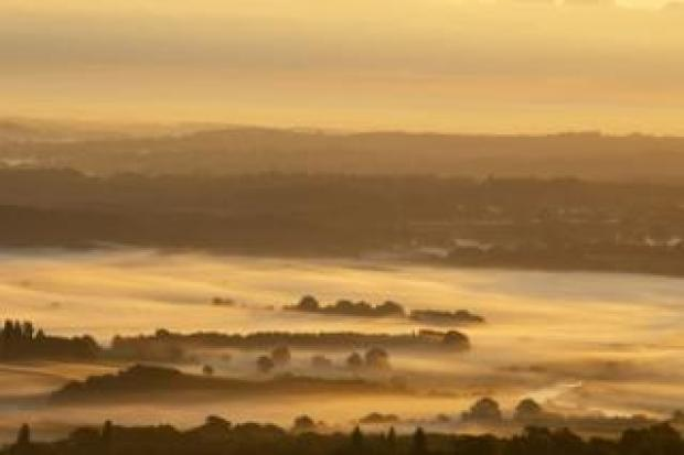 The sun rises over the South Downs National Park